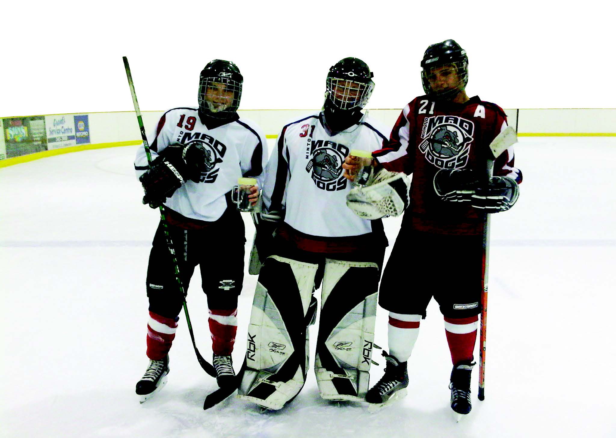 Minto Mad Dogs, from left: Anthony McKinnon, Curtis Ferguson and Zach Leslie competed for the home side in the skills competition at the 2010 Minto Midget LL tourney. Greg Korber photo