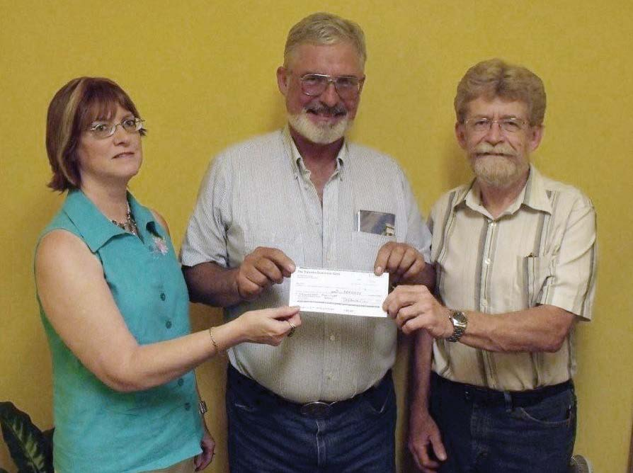 Marie Randall of Mount Forest Insurance and John Burgess of Kimbal Printing co-sponsors of the Thunder Road Cruise present Louise Marshall Hospital Foundation Chair Murray Calder (centre) with a cheque for $1,000 from the proceeds of the Thunder Road Cruise on July 1. The funds will be used for the hospital's oncology unit.
