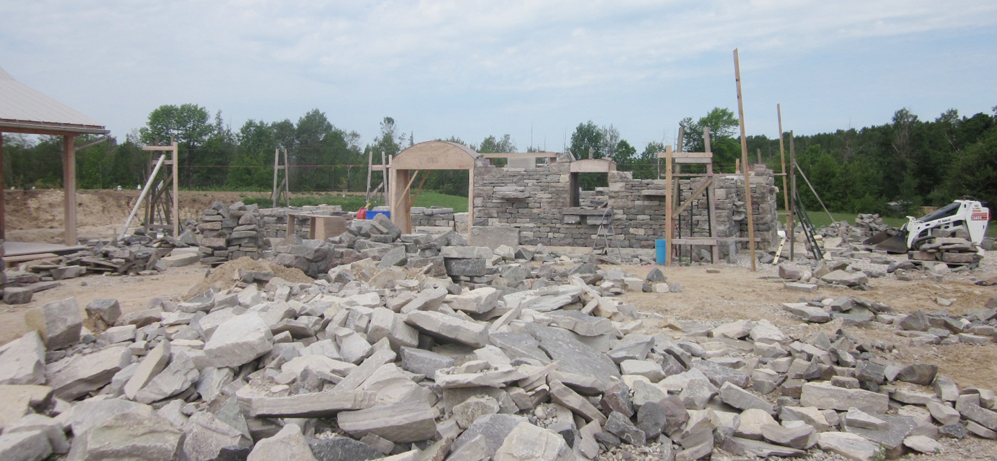 The progress of the Stable  in early August (note the amount of stone which must be available