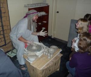 The Marketplace Potter explains his trade