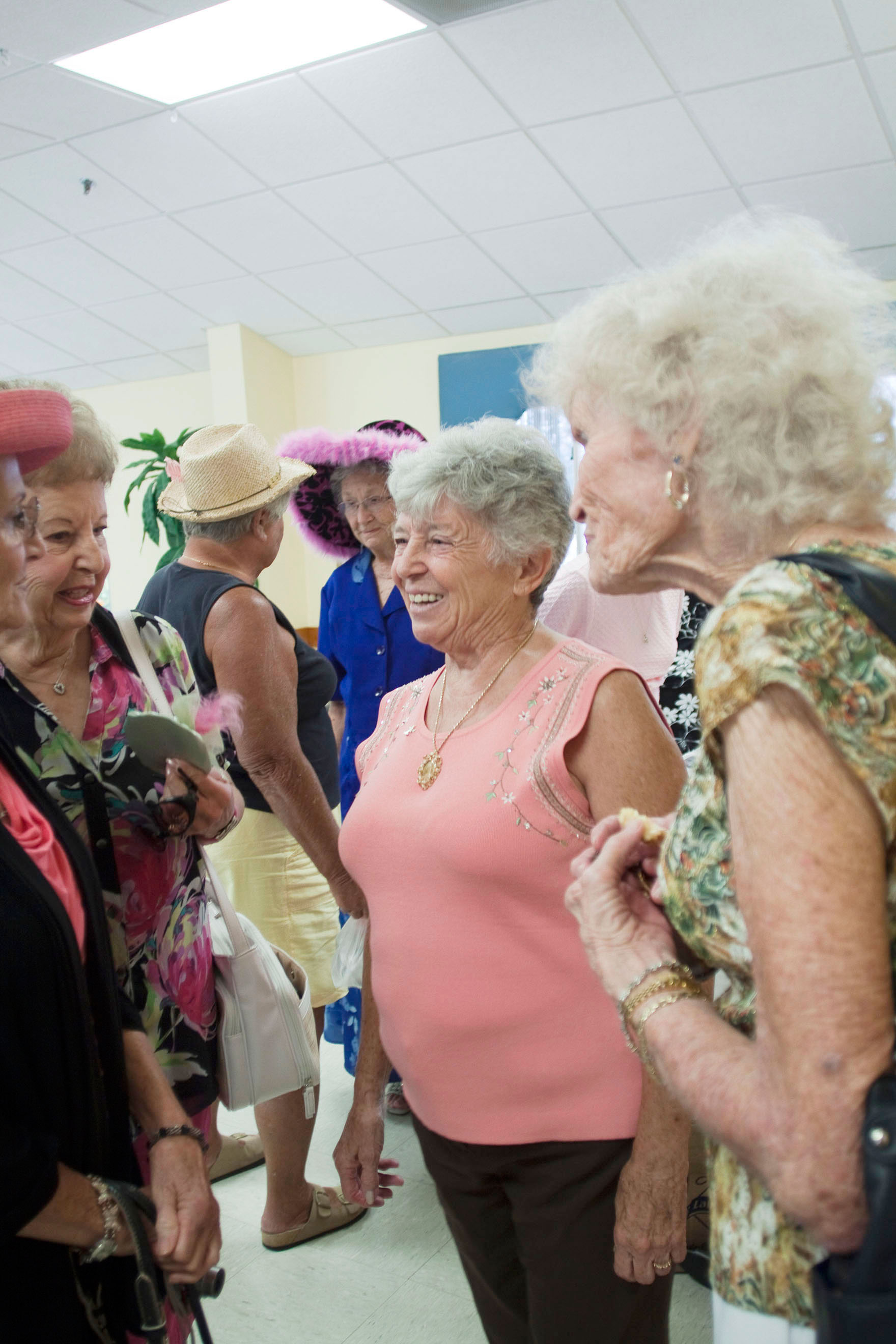 Pam Reno, former glove maker to Queen Elizabeth II, talks with friends at a tea in her honor at the Harbor Club of Bonita Springs