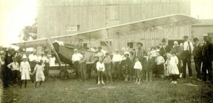 An airplane which landed in field behind the barn in July 1918 provided an opportunioty for pictures a it waited for repairs.
