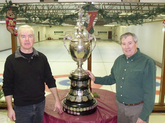 Kim MacKenzie, left and George Bridge, of the Harriston Curling Club pose with the historic Meiklejohn Trophy. Patrick Raftis photo