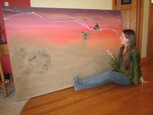 Dana Jaunzemis explains her interpretation of the turtles leaving the burrow.  Both the burrow and the turtles are three dimensional and that's real sand on the canvas.