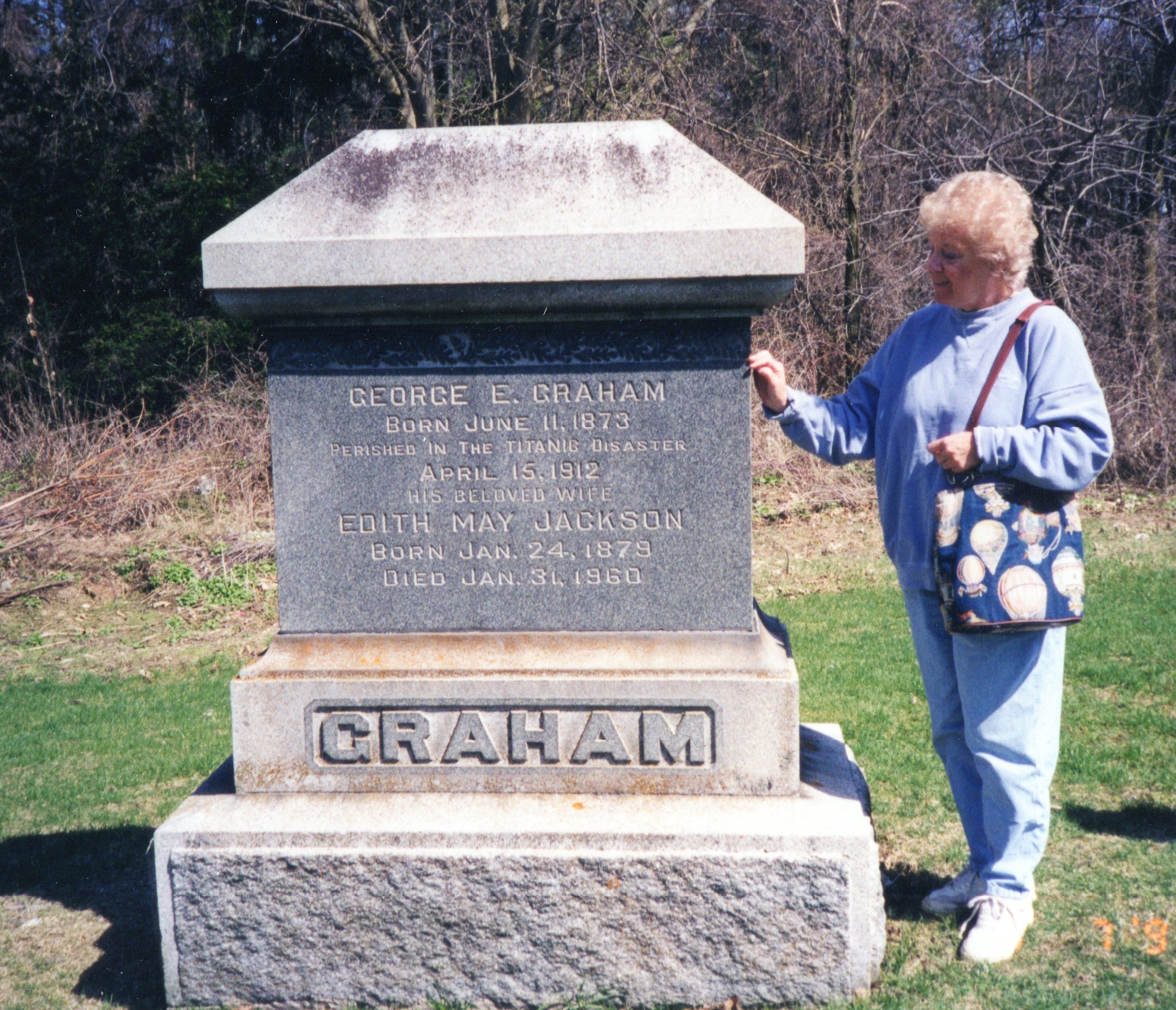 Erland Greenwood stands beside the Graham Family tombstone in St Marys Cemetery. Howard Greenwood photo