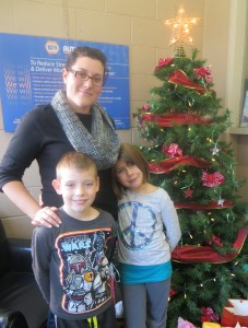 Amy Habermehl with her two children Quinn and Ella beside the 2013 Christmas tree (Sue Bridge photo)
