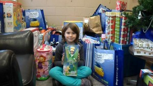 Ella Habermehl surrounded by just some of the 2012 Gifts for Kids parcels (Amy Habermehl photo)