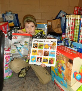 Quinn Habermehl showing just some of the 2012 Gifts for Kids packages (Amy Habermehl photo)