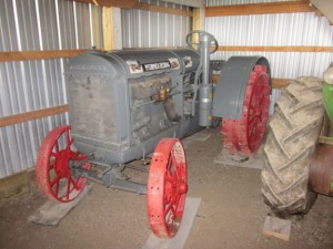 His father's restored McCormick-Deering back on steel