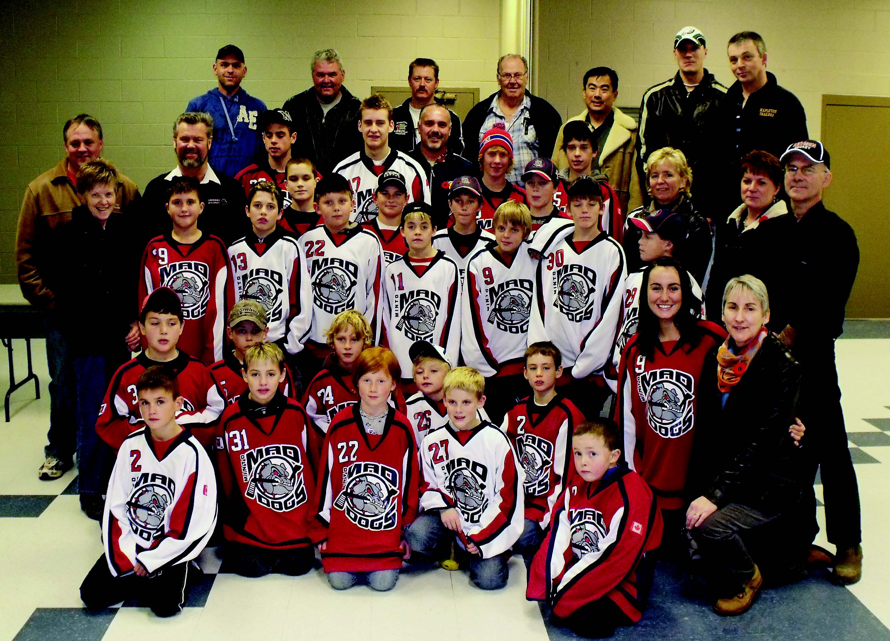 Sponsors and players wearing the new Minto Minor Hockey jerseys got together at a presentation of the new gear prior to the Palmerston 81's home game, Nov. 7. Sponsors covered the $22,000 cost of new jerseys for all MMH teams from Novice up. Patrick Raftis photo