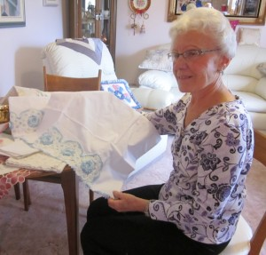 Marlyn Bramhill holding a pillowcase similar to those forwarded to the queen.