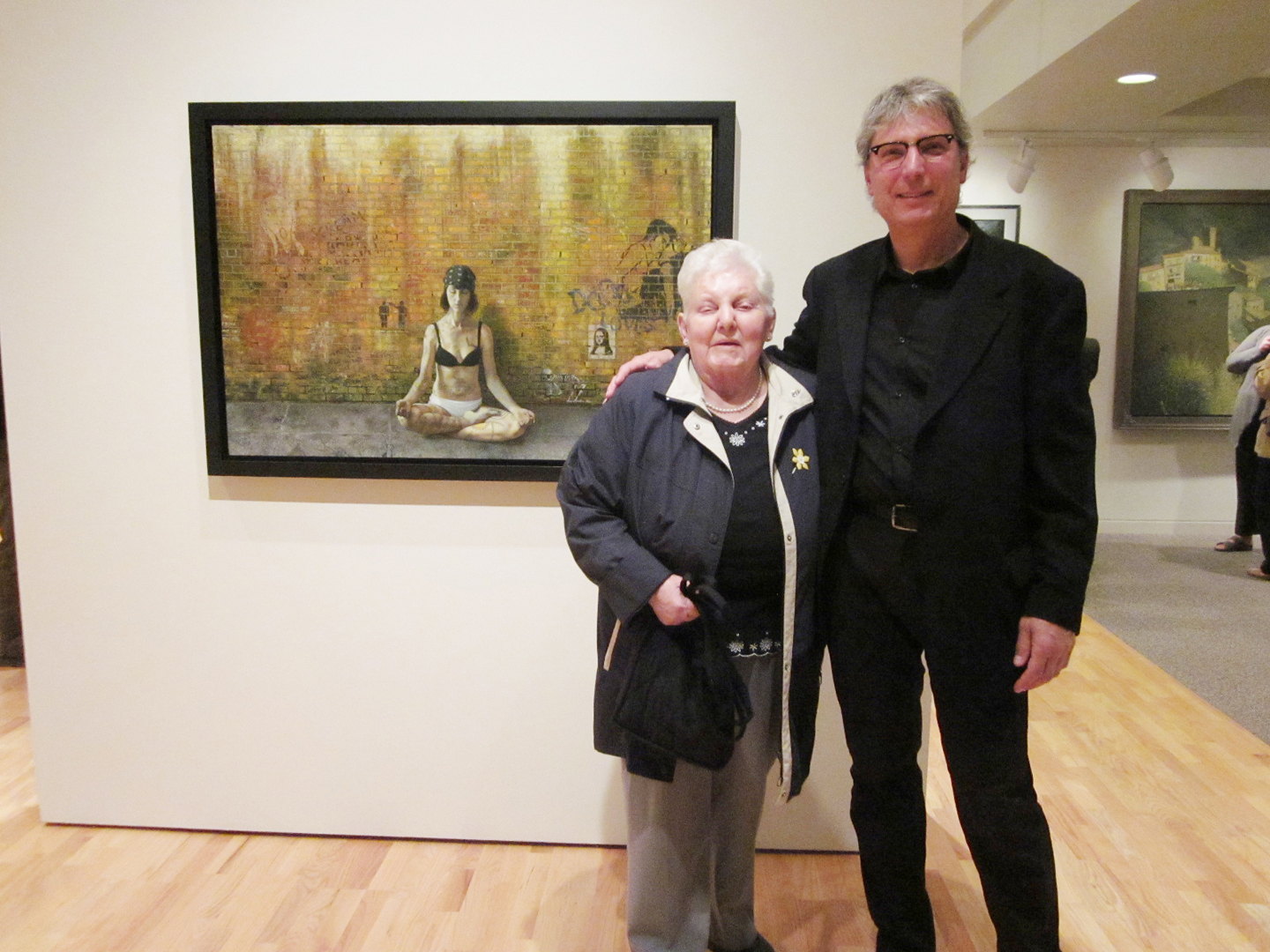 Artist Tony Luciani greets Maxine Heise of Harriston at the opening of a display of his work at the Wellington County Museum. Willa Wick photo