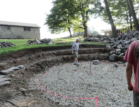 John explaining how to build the amphitheatre seats