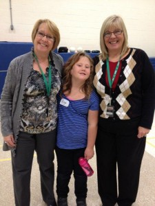 W.Ross Macdonald School consultants Grace Soledat (left) and Sue Bendall pose with Enya Kelly.  Sue has been Enya's Deafblind Resource consultant since Grade 2.