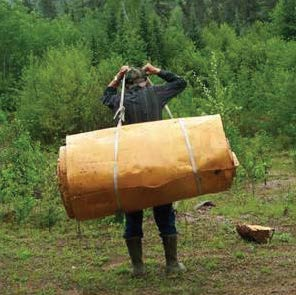 Once removed, the bark is rolled up and carried out of the bush with a tarpaulin. Photo courtesy Marcel Labelle
