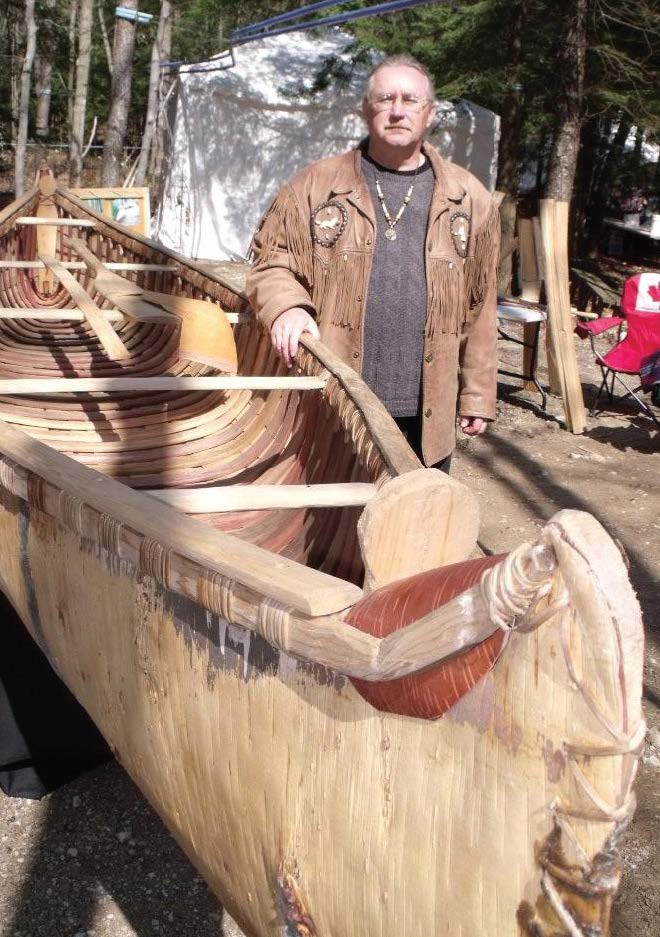 Master canoe builder Marcel Labelle with a canoe he displayed at the Maplefest in Holstein in the spring of 2010. Patrick Raftis photo