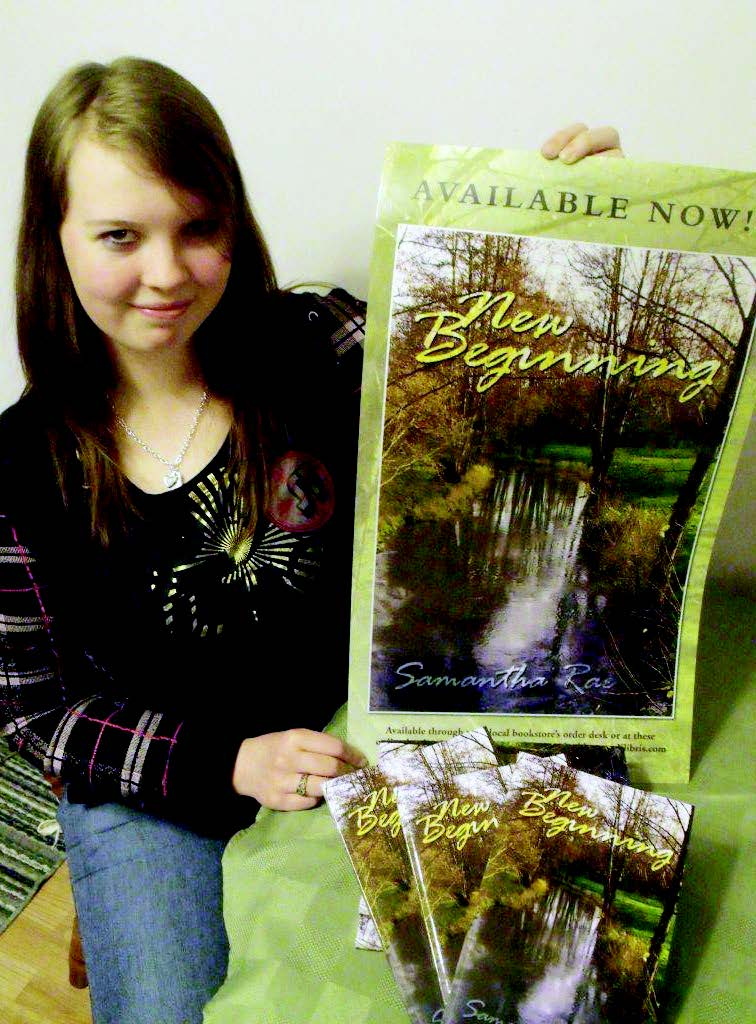 Samantha Rae, 17, of Clifford, poses with a poster and copies of her new self-published novel, New Beginnings. Patrick Raftis photo