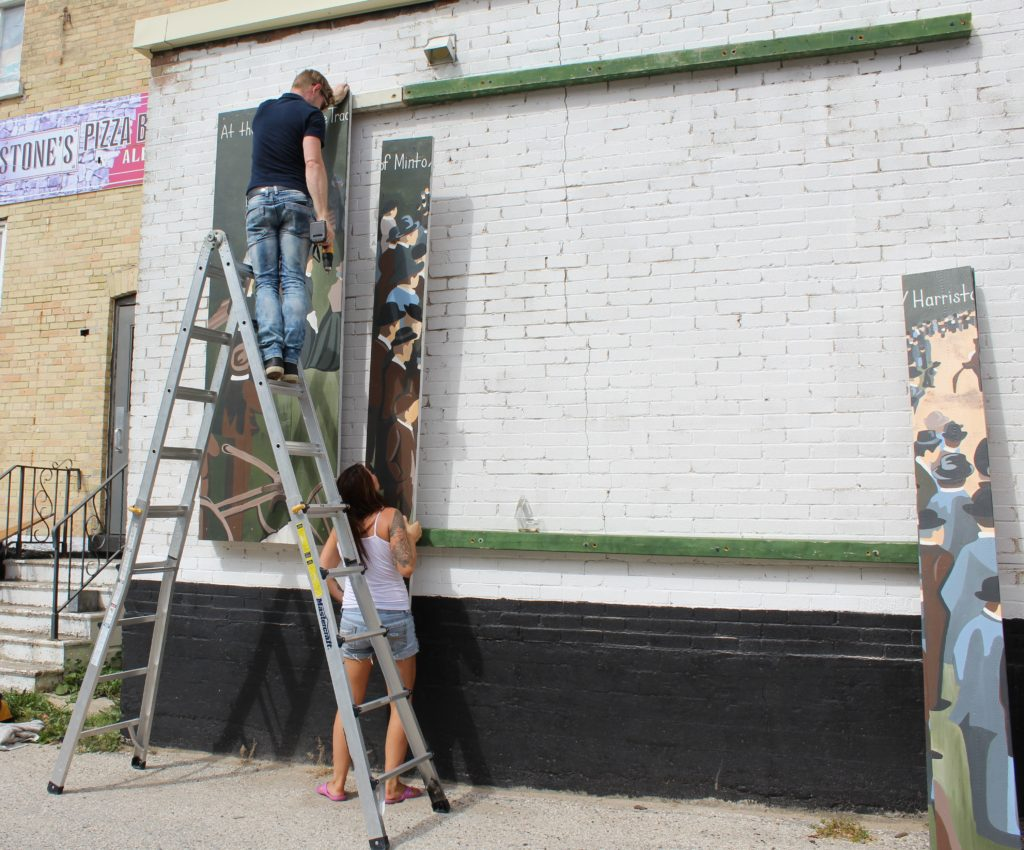 Alisha Forbes and Chad Tailor start the boards for the mural