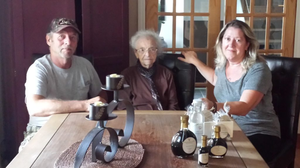 Bert and Kathy Beilke, along with Bert's 96 year old grandmother, show off the current line of Wagram Springs products. (Beilke photo)